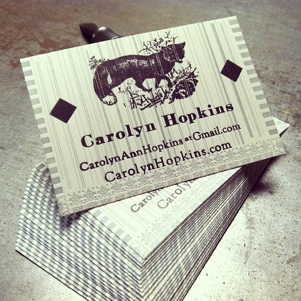 Business card for Carolyn, two colors on bright white cover stock.